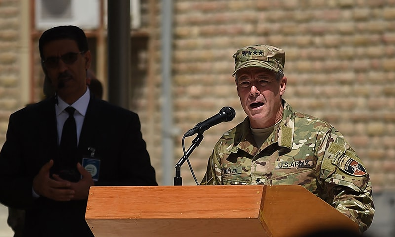 Incoming General Scott Miller, command of US and NATO forces in Afghanistan gestures as he speaks during a change of command ceremony at Resolute Support in Kabul on September 2, 2018.  —AFP