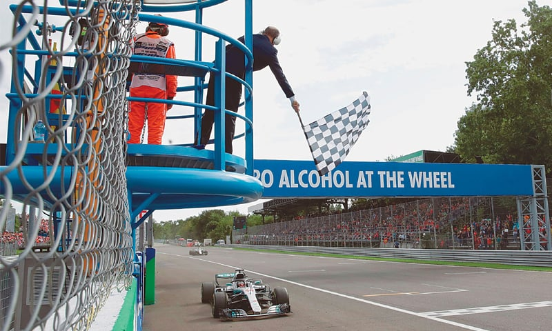 MONZA: Mercedes' driver Lewis Hamilton crosses the finish line to win the Italian F1 Grand Prix at the Autodromo Nazionale circuit on Sunday.—AFP