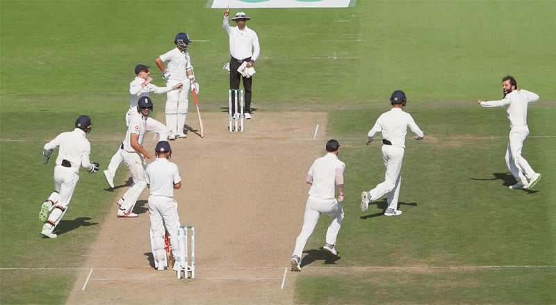 ENGLAND spinner Moeen Ali (top right) celebrates with team-mates after taking the wicket of Indian captain Virat Kohli during the fourth Test at the Ageas Bowl on Sunday.—AP