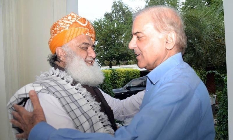 PML-N president Shahbaz Sharif receives JUI-F chief Maulana Fazlur Rehman at his Model Town residence on Sunday.—Dawn