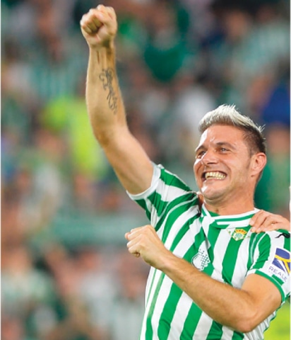 SEVILLE: Real Betis' Joaquin celebrates at the end of the La Liga match against Sevilla FC at the Benito Villamarin Stadium.—AFP