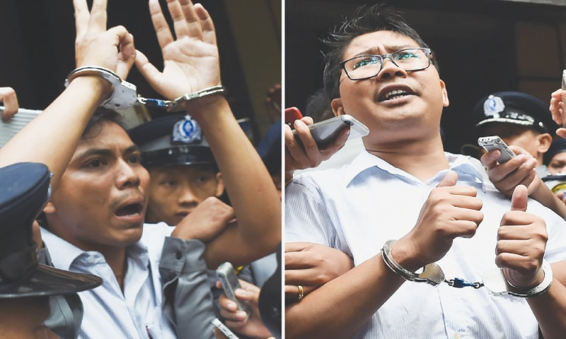 This combo shows journalists Kyaw Soe Oo (left) and Wa Lone being escorted by police from a court to jail in Yangon on Monday.—AFP