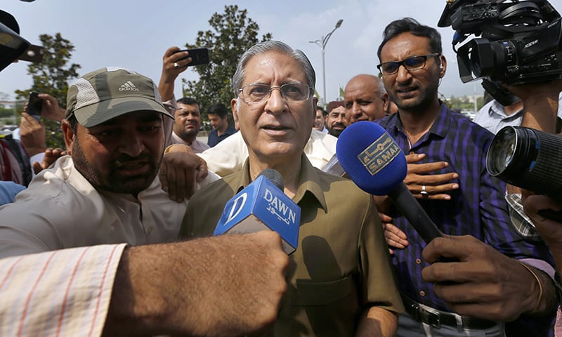 PPP candidate Aitzaz Ahsan arrives at parliament in Islamabad. — AP