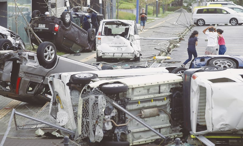 The vehicles damaged by Typhoon Jebi in Osaka on Tuesday.—Reuters
