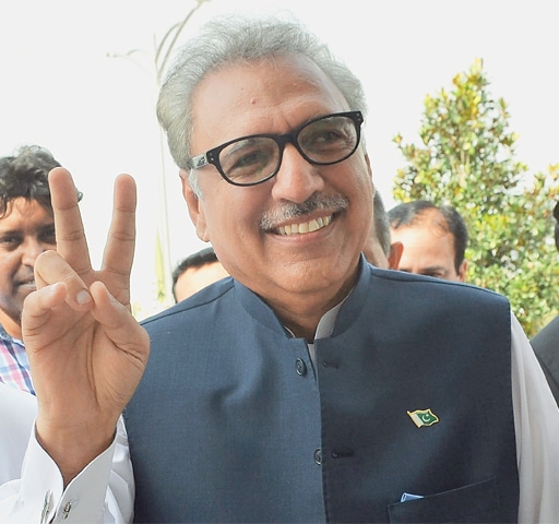Dr Arif Alvi is all smiles as he arrives at Parliament House for the election. —AFP