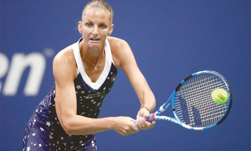 CZECH Republic's Karolina Pliskova returns the ball against Serena Williams of the US during their quarter-final.—AFP