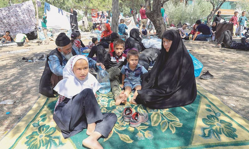 ANKARA: Afghan refugees rest at a makeshift camp in a park.—AFP