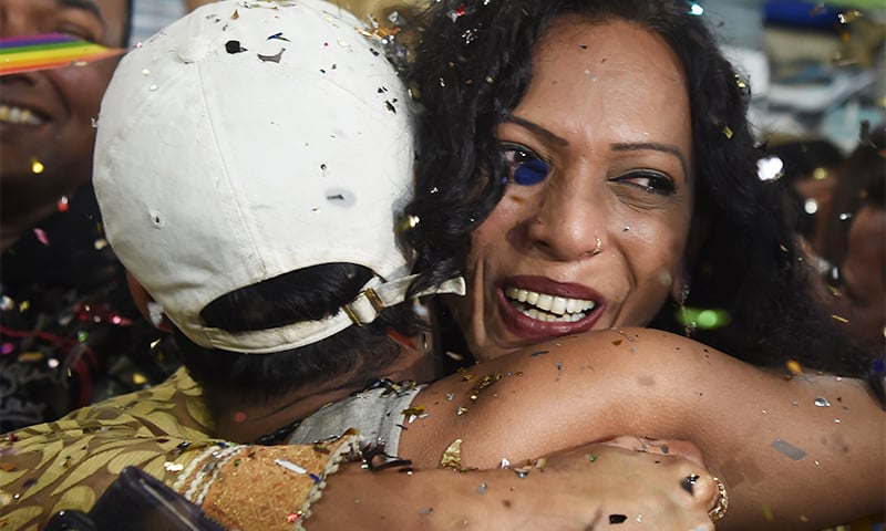 Supporters and members of the LGBT community hug and celebrate the judgement. ─ AFP