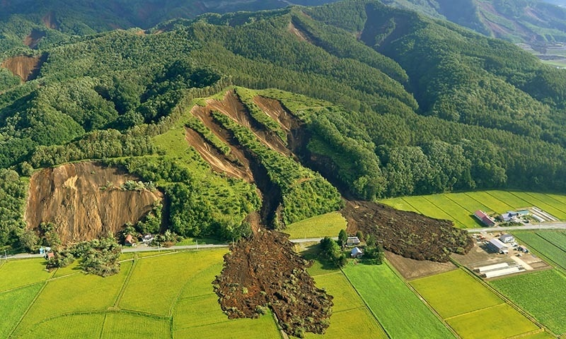 This picture shows an aerial view of a landslide in Atsuma town, Hokkaido prefecture — AFP