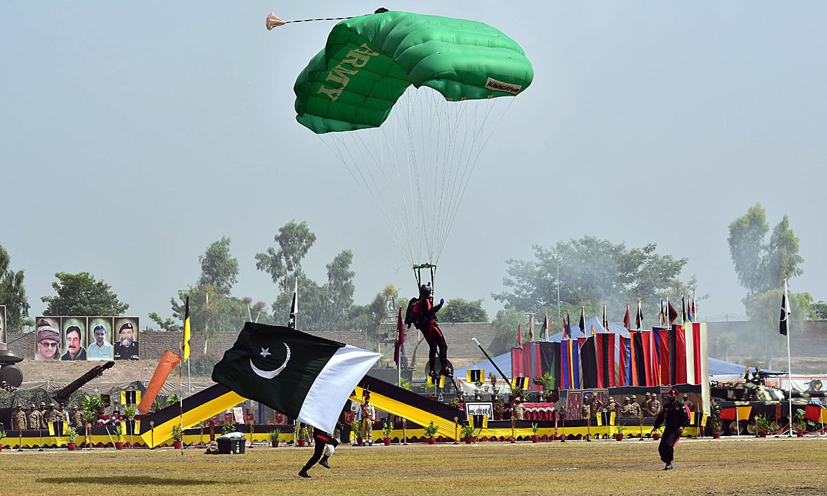 Army para-troopers demonstrating their skills at Karnal Sher Khan (Shaheed) Stadium. — APP