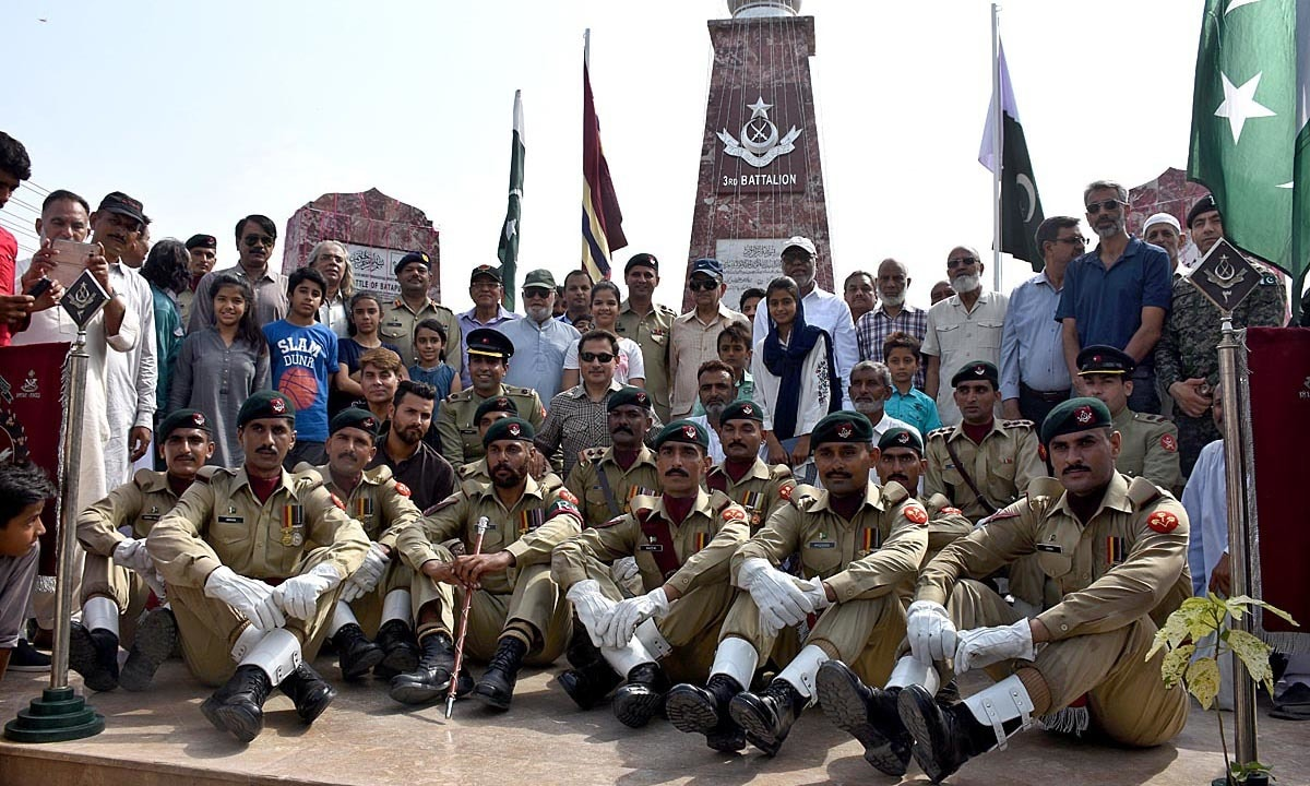 A group photo of Lt Col Muhammad Adnan Ul Haq at the 3rd Baloch Regiment Monument at Batapur in connection with Defence Day of Pakistan. — APP