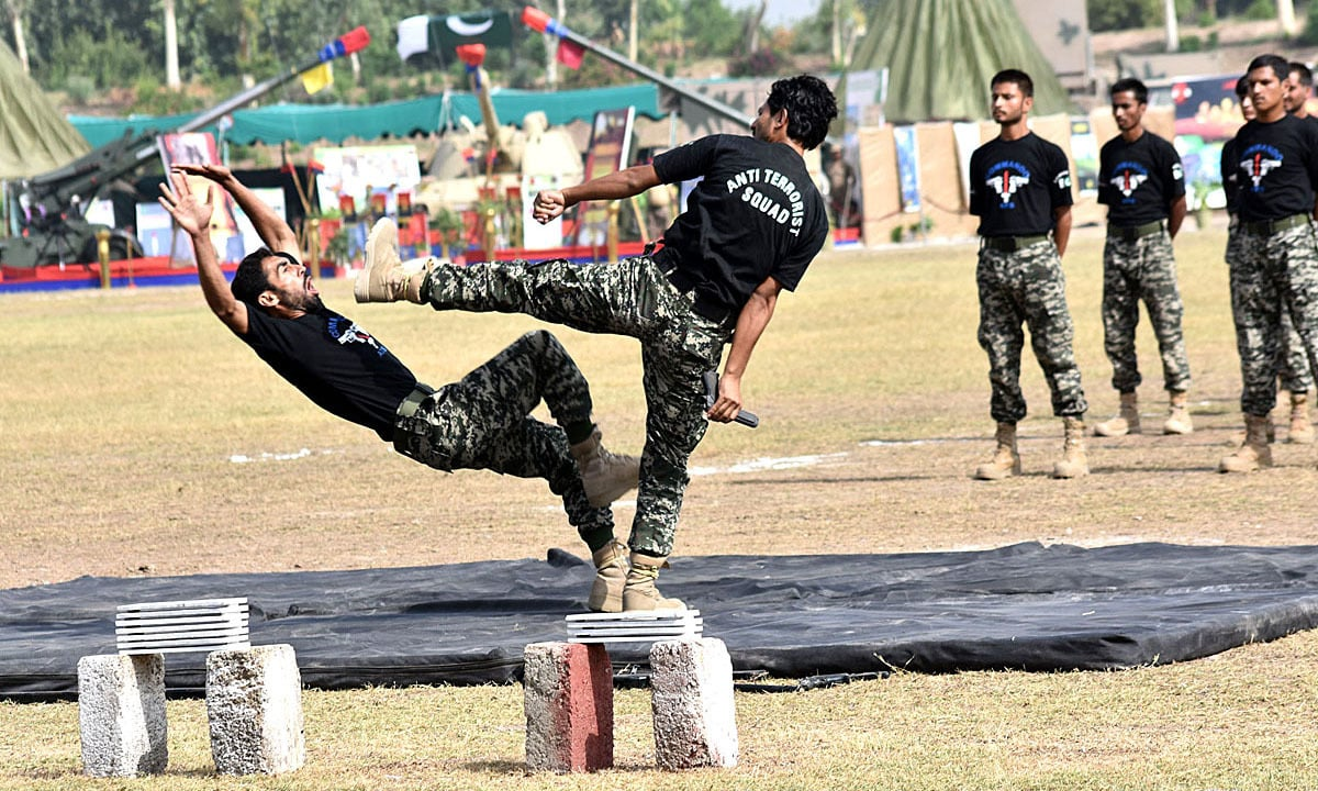 Army personnel demonstrating their skills during a programme to mark the Defence Day. — APP