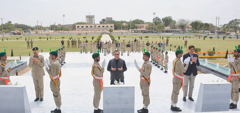THE Karachi corps commander, Sindh governor and chief minister offer fateha at Yadgar-i-Shuhada in Malir Garrison on Thursday.—Online
