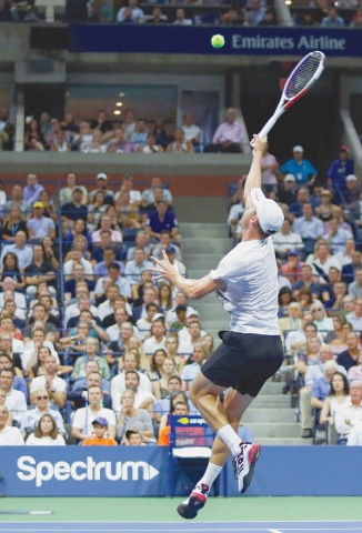 NEW YORK: Australia's John Millman hits a return to Novak Djokovic of Serbia during their US Open quarter-final at the USTA Billie Jean King National Tennis Center.—AFP