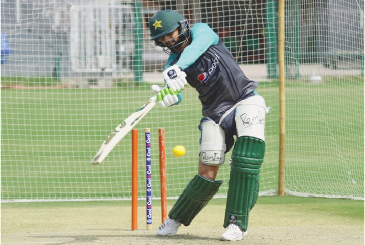 LAHORE: Pakistan batsman Shoaib Malik bats during a nets session at the Gaddafi Stadium on Thursday, as a part of the training camp for the upcoming Asia Cup.—M. Arif/ White Star