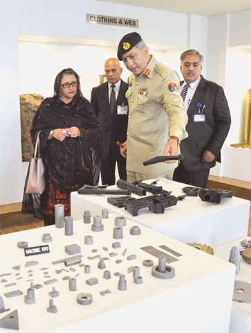 Federal Minister for Defence Production Zubaida Jalal is being briefed about POF products.—Dawn.