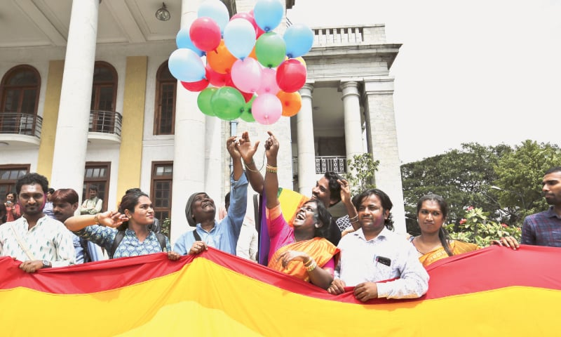 BANGALORE: Transgender rights activist Akkai Padmashali (in orange) celebrates with other members of the LGBT community the court judgement on Thursday.—AP