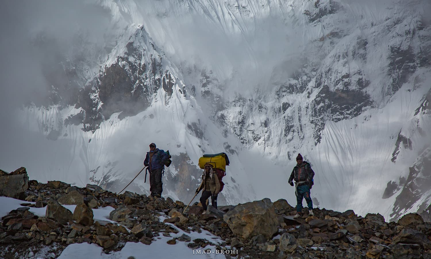 The team crosses the crevasse safely.
