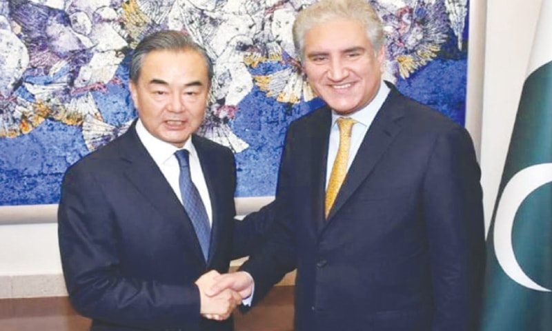 FOREIGN Minister Shah Mehmood Qureshi shakes hands with his Chinese counterpart Wang Yi at the Foreign Office.—White Star