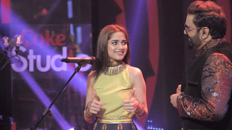 Aima Baig giving Sahir Ali Bagga two thumbs up after recording their song Baazi.