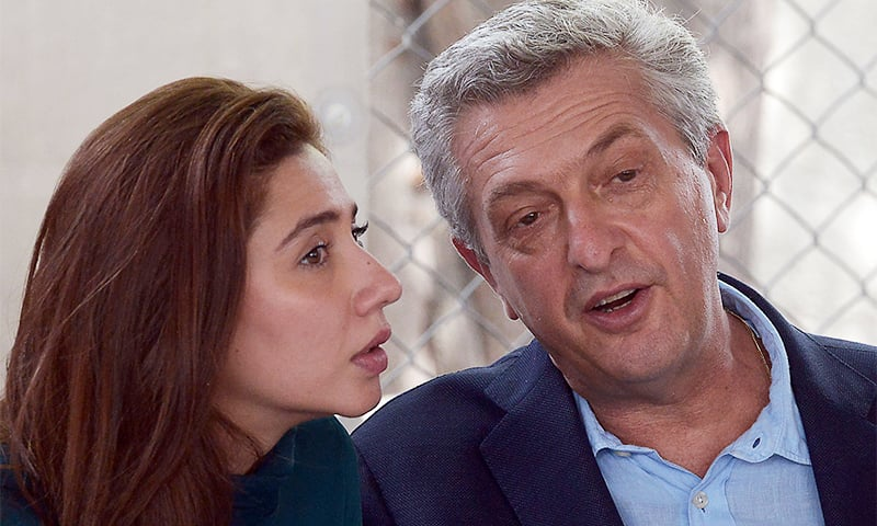 United Nations High Commissioner for Refugees Filippo Grandi (R) and actress and UNHCR advocate for refugees and youth Mahira Khan (L) brief media during their visit at the Azakhel Voluntary Repatriation Centre in Nowshera on September 8. ─ AFP