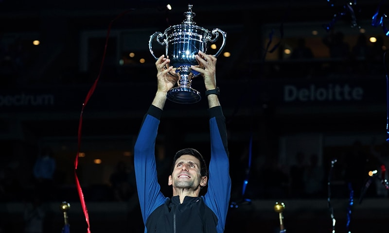 Serbia's Novak Djokovic holds the trophy after winning against Argentina's Juan Martin del Potro during their Men's Singles Finals match at the 2018 US Open at the USTA Billie Jean King National Tennis Center in New York. — AFP