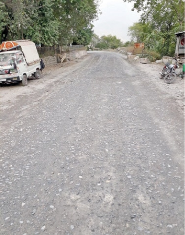 The road connecting Punjab with AJK has been in a dilapidated condition for over 15 years. — Dawn