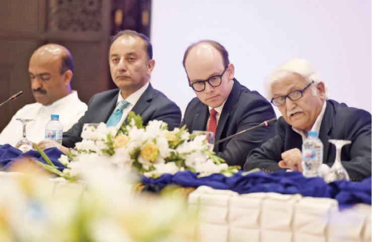 Former senator Farhatullah Babar speaks at the book launch on Monday. PTI's Nadeem Afzal Chan and Senator Mussadiq Malik of the PML-N are also seen. — White Star