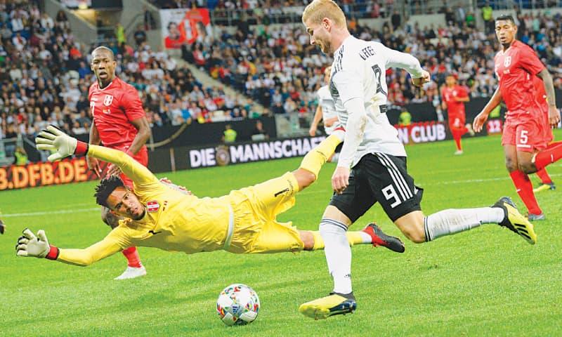 SINSHEIM: Peru goalkeeper Pedro Gallese saves a shot by Germany's Timo Werner during their international friendly at the Rhein-Neckar-Arena.—AFP