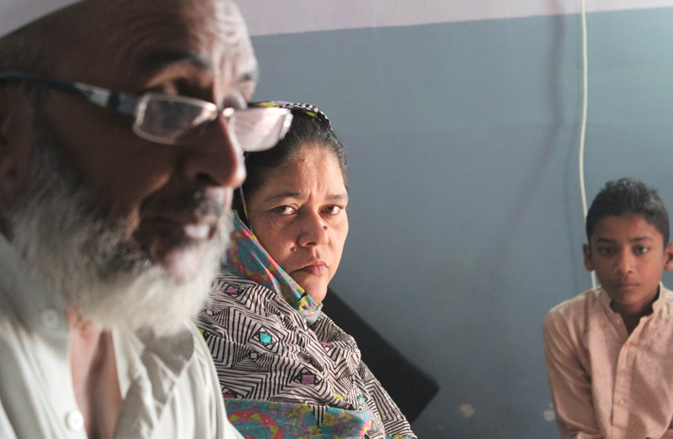 Aziz Bhai and his wife lament the loss of their 19-year-old son in the Baldia inferno | Photo by Danyal Adam Khan