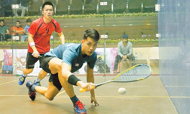 ISLAMABAD: Players in action during the second round of the CAS International Championship at the Mushaf Squash Complex on Tuesday.—INP