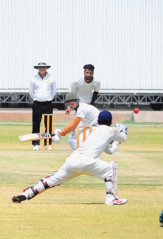 MULTAN: Wapda paceman Ehsan Adil bowls during the Quaid-i-Azam Trophy match against Multan at the Multan Cricket Stadium on Tuesday.—APP