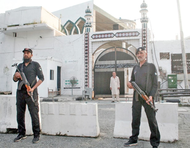 Security personnel stand outside the G-6 Imambargah on Tuesday. — Online