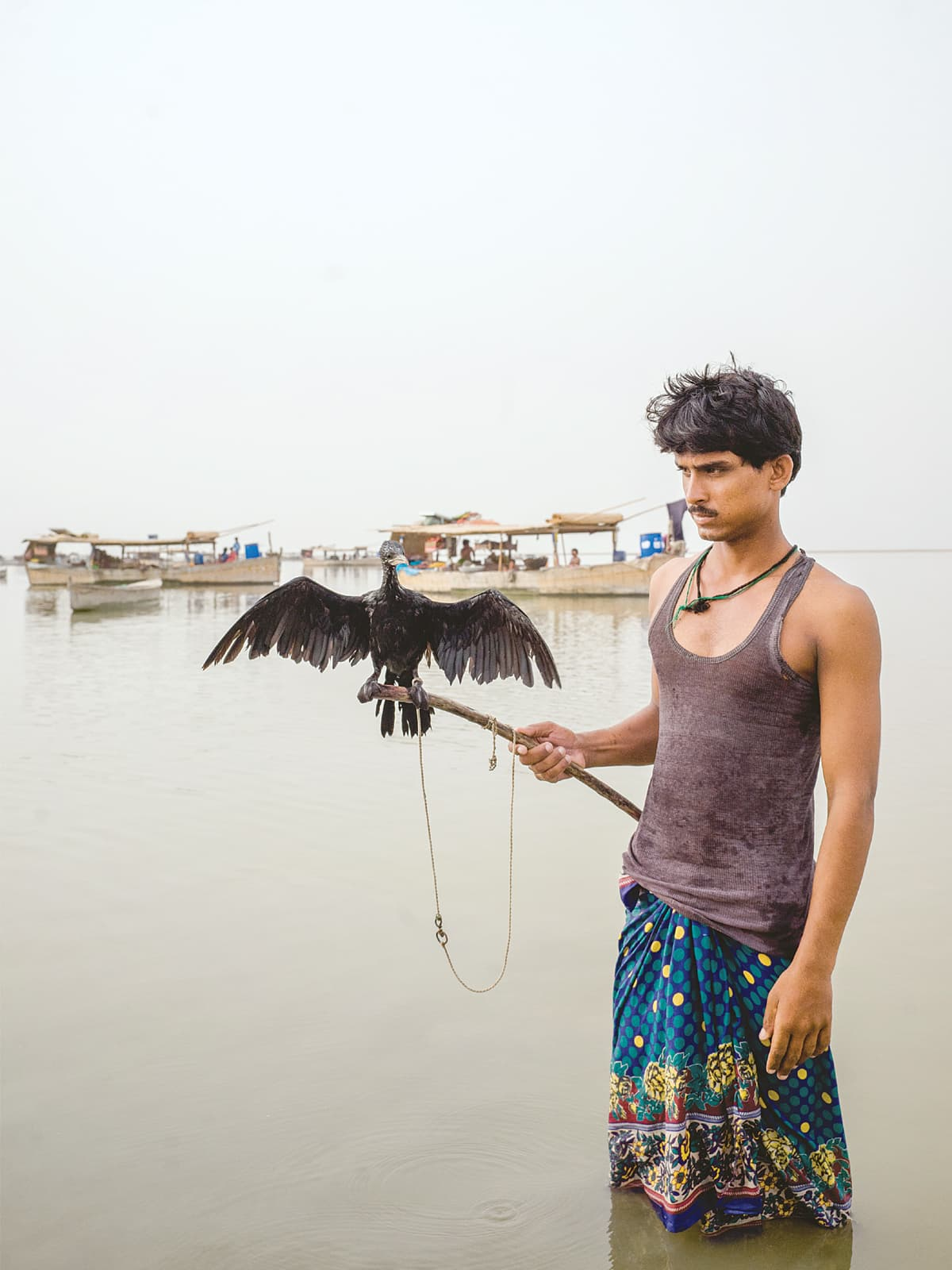 Bird hunting is a routine way to pass time at Manchar Lake