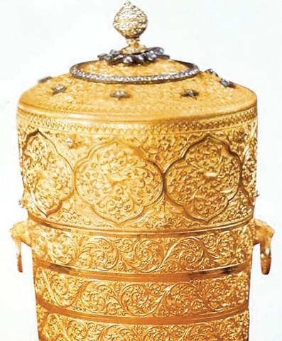 THE golden lunch box is worth millions of dollars.