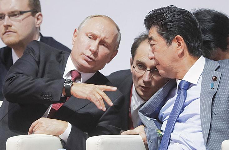 Vladivostok, Russia: Russian President Vladimir Putin speaks to Japanese Prime Minister Shinzo Abe on Wednesday.—AP