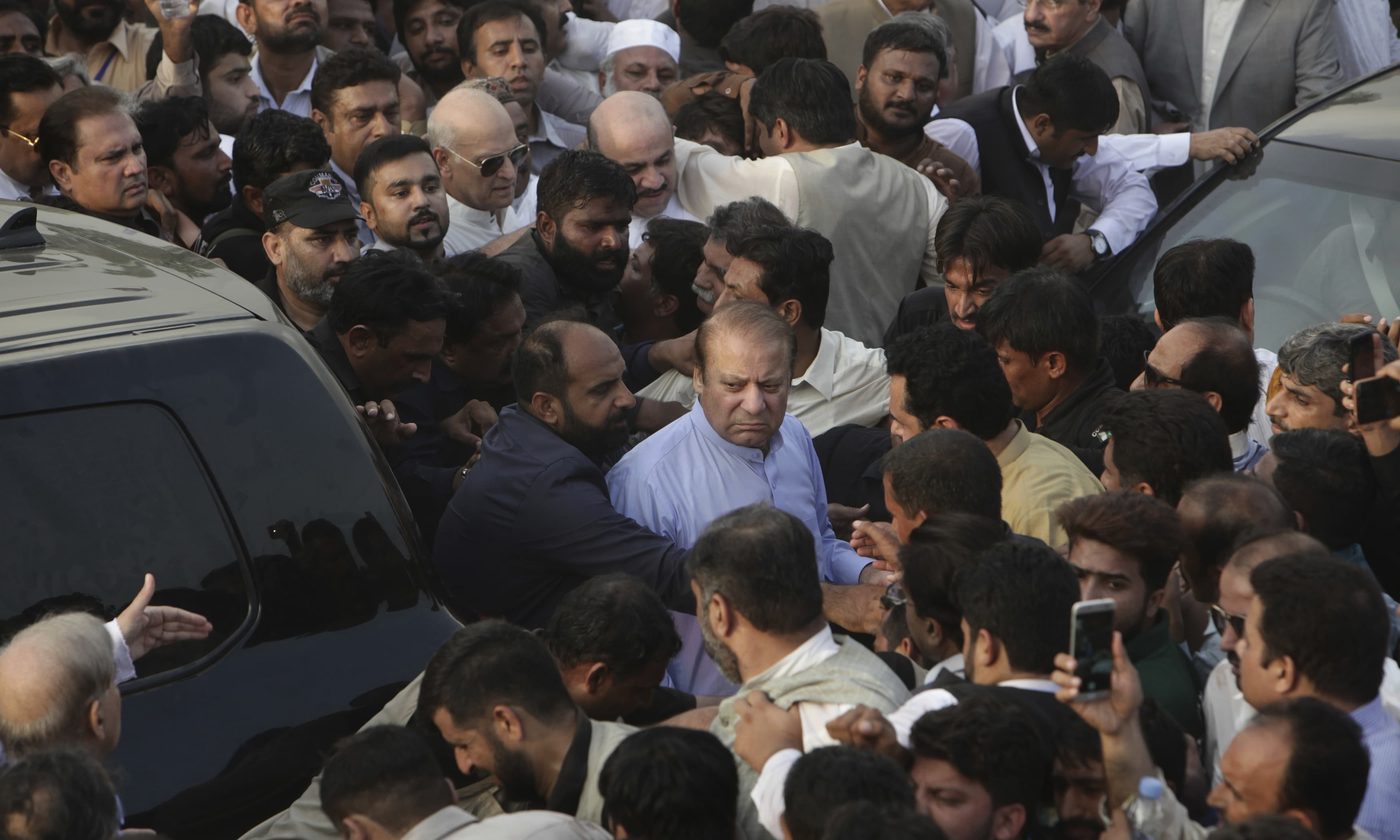 Jailed former prime minister Nawaz Sharif arrives to attend the funeral of his wife Kulsoom Nawaz in Lahore. —AP