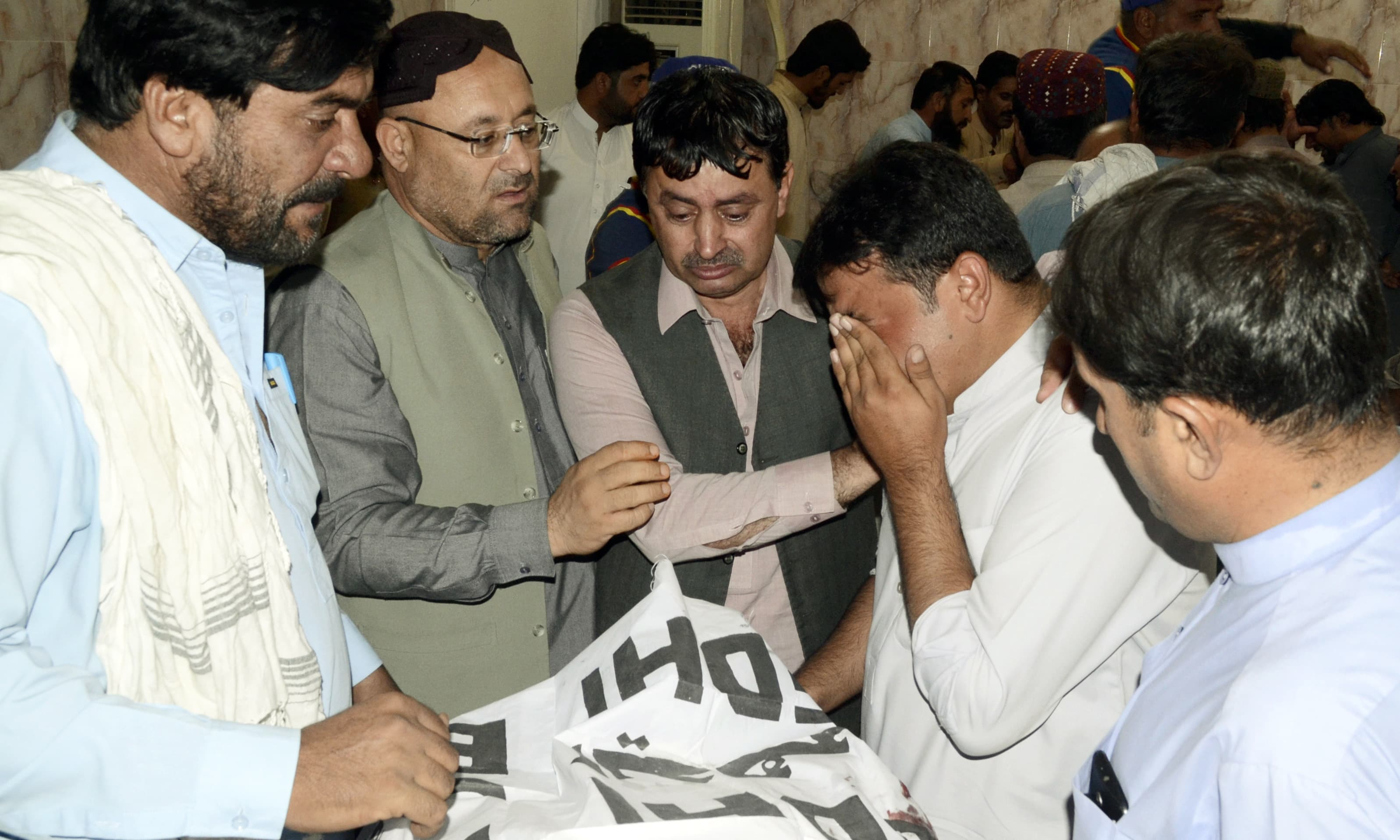 People mourn the death of their family member who was killed in a blast in Quetta. —AP