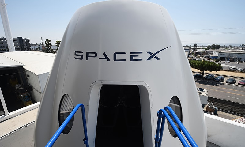 In this file photo taken on August 13, 2018 a mock up of the Crew Dragon spacecraft is displayed during a media tour of SpaceX headquarters and rocket factory in Hawthorne, California. —AFP