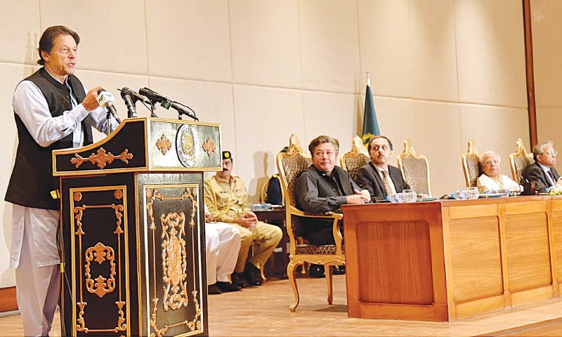 ISLAMABAD: Prime Minister Imran Khan addresses civil servants at PM Office on Friday.—INP