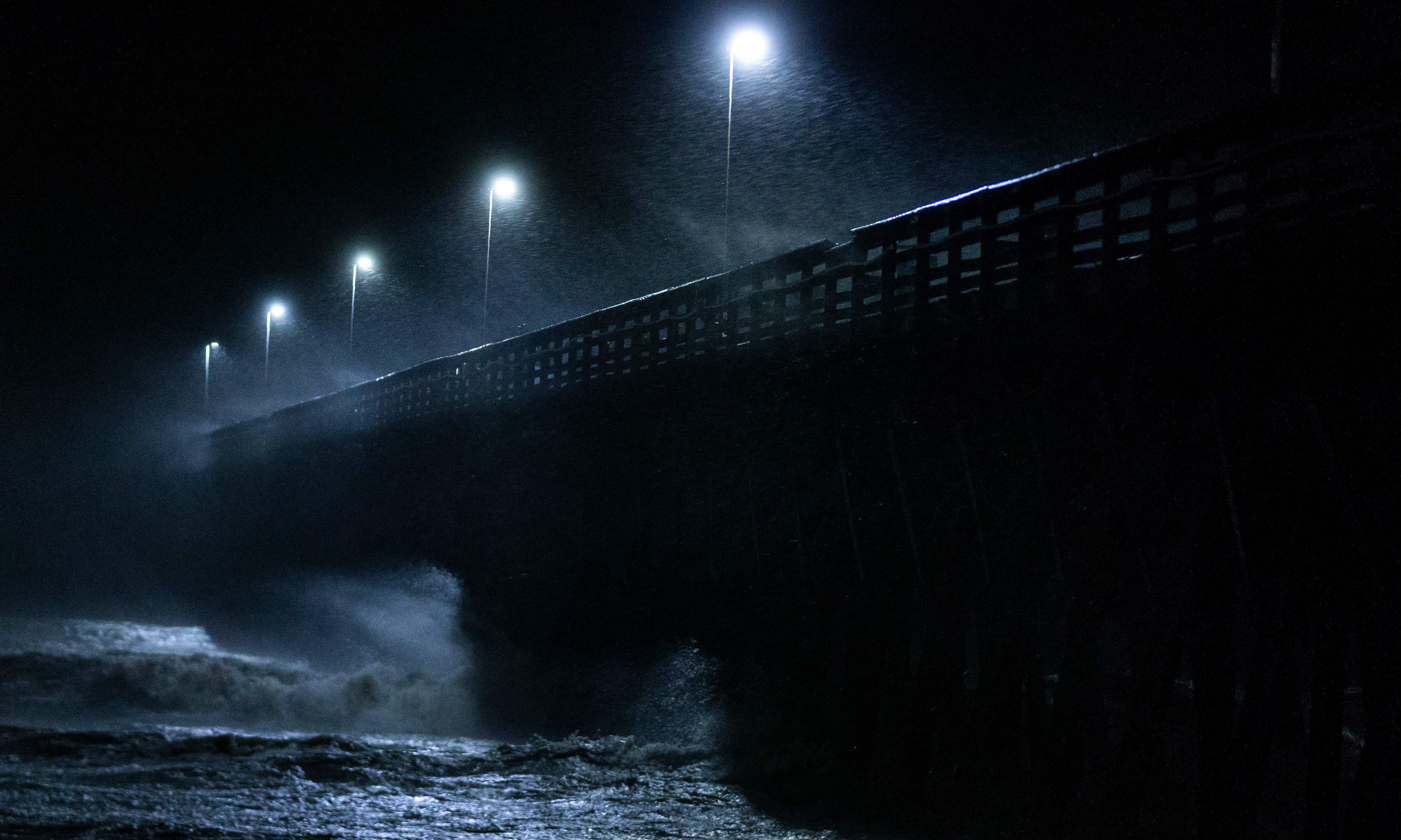 Waves crash into the Second Avenue Pier as Hurricane Florence makes landfall late on September 14 — AFP