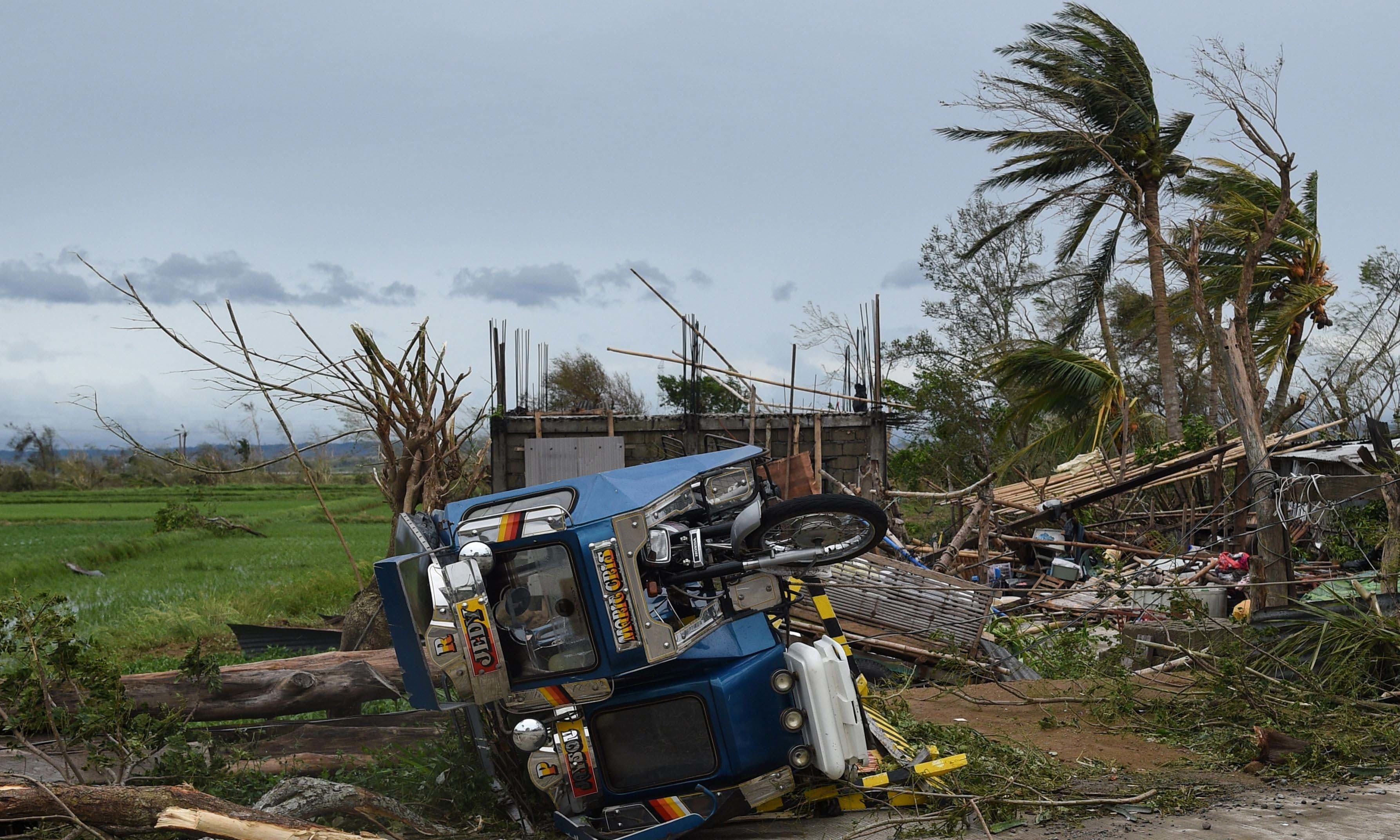 An overturned tricycle is seen next to a destroyed house after Super Typhoon Mangkhut hit the town of Alcala, Cagayan province. — AFP