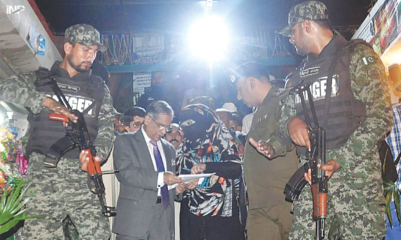 CHIEF Justice of Pakistan Mian Saqib Nisar listens to problems of a woman after visiting Darbar Hazrat Syed Baba Shah Jamal on Saturday.—INP