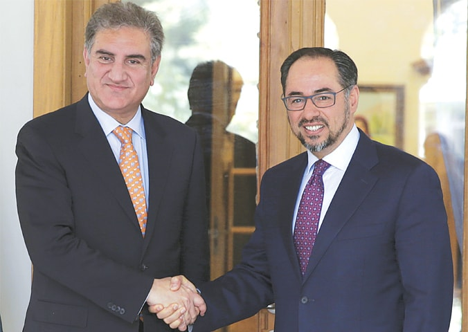 KABUL: Foreign Minister Shah Mehmood Qureshi shakes hands with his Afghan counterpart Salahuddin Rabbani on Saturday.—AP