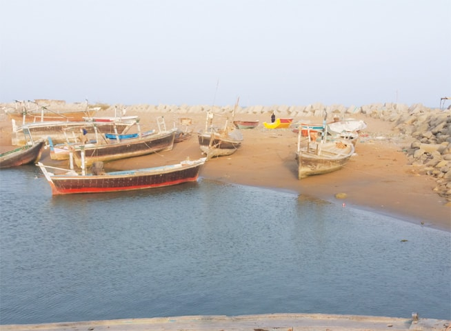 BOATS are stuck in sand at Pasni's harbour.—Writer