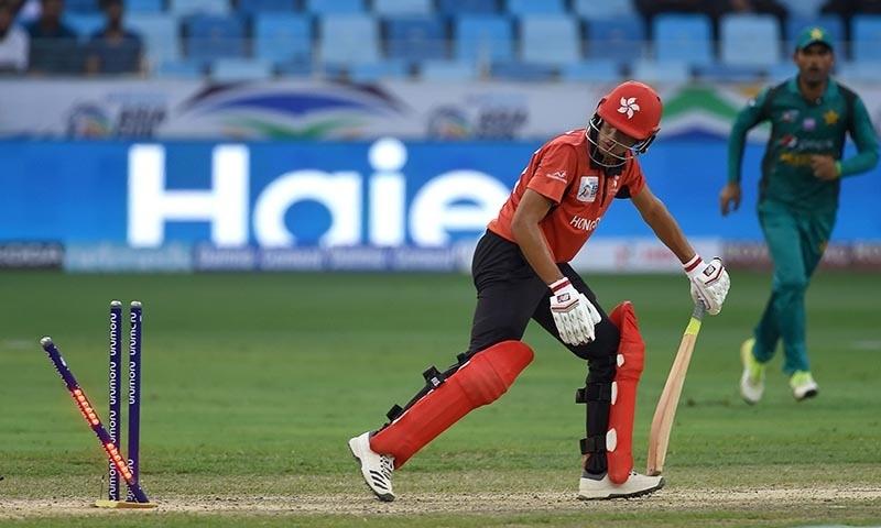 Hong Kong batsman Aizaz Khan is dismissed by Pakistan cricketer Usman Khan — AFP