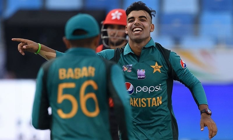Shadab Khan (R) celebrates with teammate after he dismissed Hong Kong batsman Babar Hayat — AFP