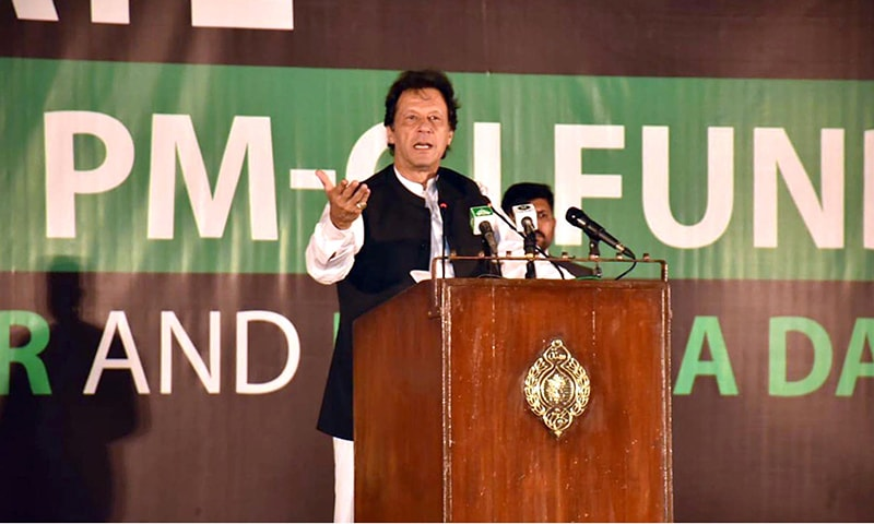 Prime Minister Imran Khan addressing the fund raising event for dams organised at Governor House. —APP