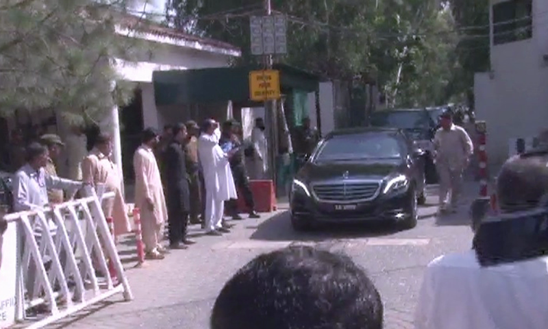 Cars carrying Sharif family members leave Jati Umra. — DawnNewsTV