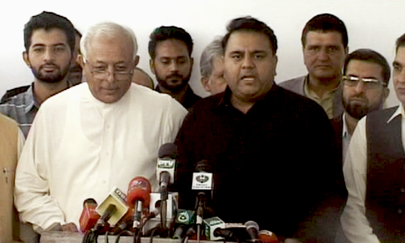 Minister for Petroleum Ghulam Sarwar Khan (left) with Minister for Information Fawad Chaudhry (right) at the press conference today. Photo: DawnNews
